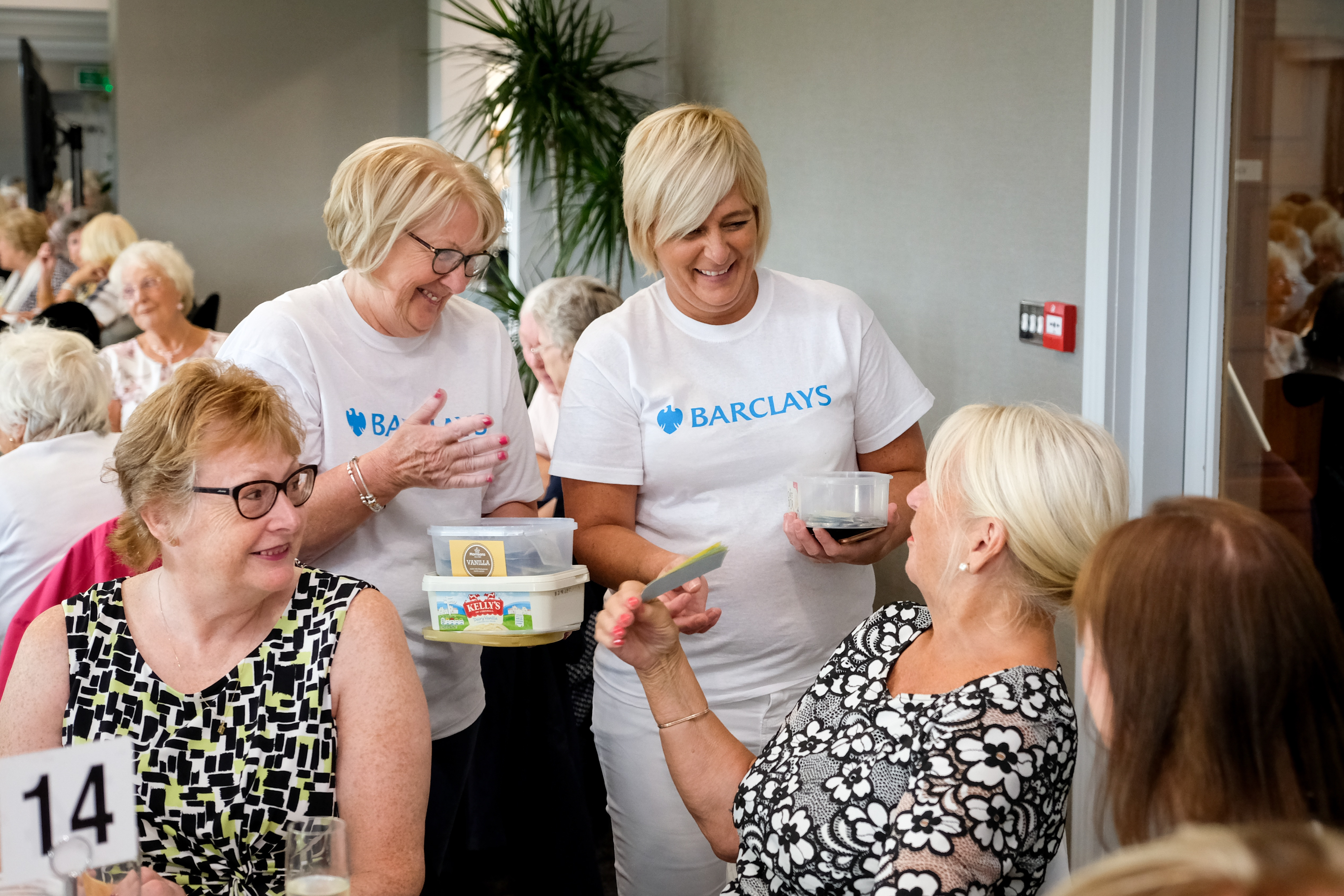 Barclays employees helping at an event